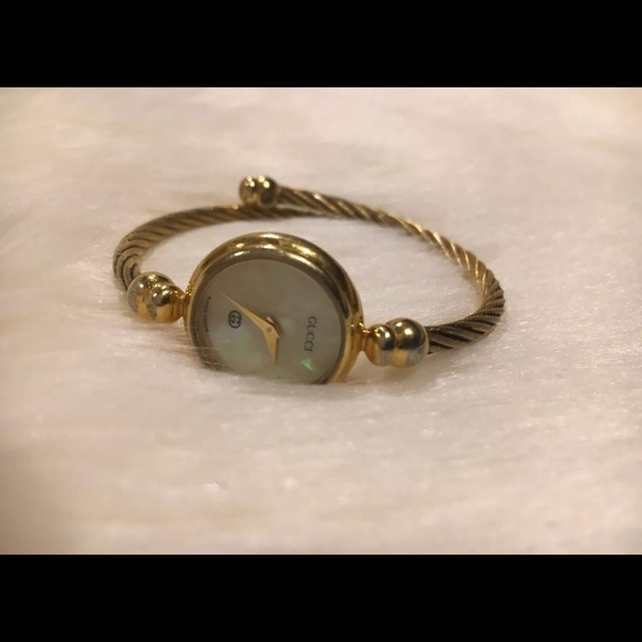 75009320e76 Gucci Accessories - Gucci watch 18k pleated gold bangle motherof pearl